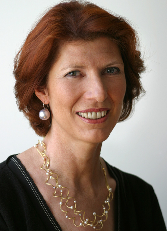 Dr. Alexandra Pifl, a red-haired caucasian woman wearing an intricate necklace